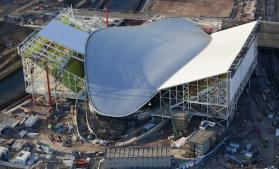 Aquatics Centre Aerial. View of the Aquatics Centre showing the development of the temporary seating areas on either side. Picture taken on 08 Feb 11 by Anthony Charlton.